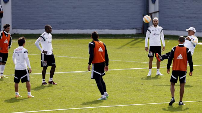 Ferretti kicks the ball to his players during a training session in Buenos Aires