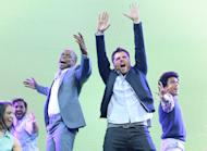 This publicity image released by USA Network shows Dule Hill, center left, and James Roday, center right, performing a musical number at the 2013 USA Network Upfront at Pier 36 in New York on Thursday, May 16, 2013. At the network's annual upfront presentation for advertisers Thursday, James Roday and Dule Hill said for the show's eighth season, which they're filming now, Roday said the cast and crew are planning to remake a previous episode. (AP Photo/USA Network, Andrew Walker)