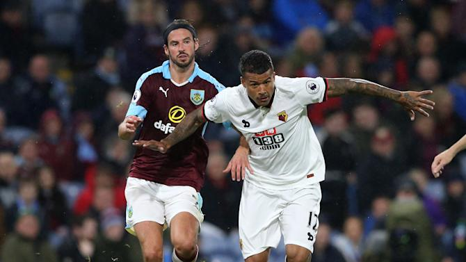 Burnley's George Boyd in action with Watford's Kenedy