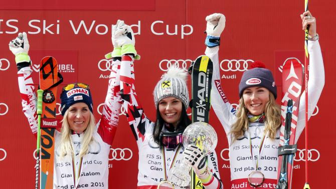 Fenninger of Austria celebrates on the podium with Austria's second placed Brem and third placed Maze of Slovenia for the women's overall giant slalom at the Alpine Skiing World Cup Finals in Meribel
