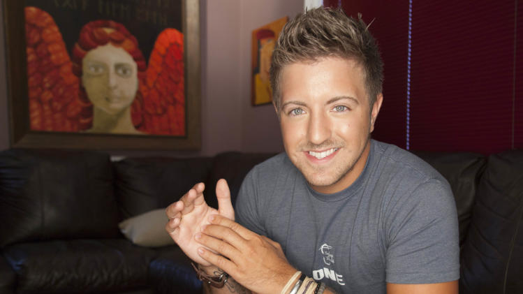 "A March 30, 2012 photo shows singer Billy Gilman in Nashville, Tenn. Gilman, 23,  co-wrote a song called ""The Choice,"" and all the proceeds are going to the organization Soles4Souls, which provides shoes for children and adults in need around the world.  (AP Photo/Ed Rode)"