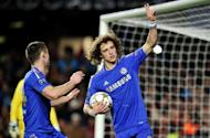 Chelsea's Brazilian defender David Luiz (R) celebrates scoring a penalty in the UEFA Champions League match against FC Nordsjaelland on December 5. The Blues routed Nordsjaelland 6-1 to secure a first victory under interim manager Rafael Benitez, but it wasn't enough to book a place in the last 16 as Chelsea became the first European champions to bow out at the group stage