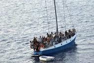 A ship carrying 65 illegal immigrants heads towards Italy on July 2. The Italian coast guard has rescued 75 immigrants from sub-Saharan Africa from a drifting dinghy on Saturday after receiving an emergency call for help by satellite phone, a spokesman tells AFP