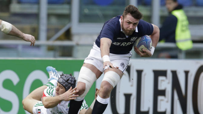 Scotland's Ryan Wilson, right, is tackled by Italy's Michele Campagnaro during a Six Nations rugby union international match between Italy and Scotland, in Rome, Saturday, Feb. 22, 2014. (AP Photo/Andrew Medichini)