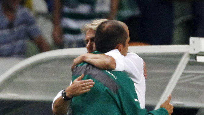 Sporting's coach Jardim and his Benfica counterpart Jesus embrace each other at the end of their Portuguese Premier League soccer match in Lisbon