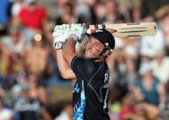 New Zealand's Hamish Rutherford hits a shot against England during the International Twenty20 cricket match at Snedden Park in Hamilton on Febuary 12, 2013. England won the toss and elected to bowl in the second one-day international against New Zealand at McLean Park on Wednesday