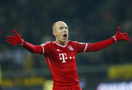 Bayern Munich's Robben celebrates after he scored a goal against Borussia Dortmund during their German first division Bundesliga soccer match in Dortmund
