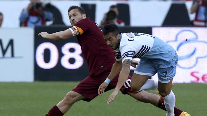 AS Roma's Totti challenges Lazio's Anderson during their Serie A soccer match at the Olympic stadium in Rome