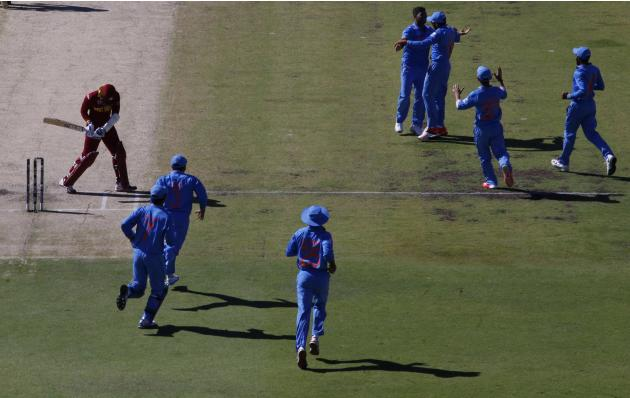 West Indies batsman Denesh Ramdin reacts after he was bowled out for a duck by India's Umesh Yadav  during their Cricket World Cup match in Perth