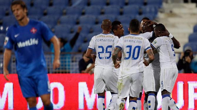 FC Porto players celebrate after scoring the opening goal against Belenenses during their Portuguese league soccer match Saturday, Nov. 2 2013, in Lisbon