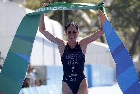 Jorgensen of the U.S. celebrates after winning the women's triathlon at the ITU World Olympic Qualification event in Rio de Janeiro