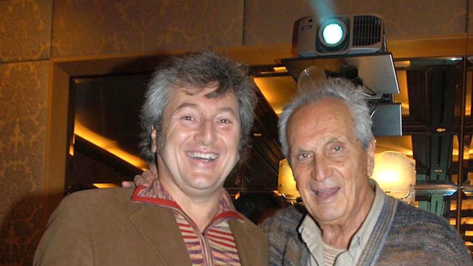 In this photo taken on Nov. 23, 2004 Vittorio Missoni, left, and his father Ottavio smile in Milan, Italy. The search resumed Saturday, Jan. 5, 2013 for a small plane that has disappeared off the Venezuelan coast with six people aboard, including Vittorio Missoni, a top executive in Italy's Missoni fashion house, officials said. Vittorio Missoni, 58, is the director general of the iconic brand and the eldest son of the company's founder. Flying with him on Friday's flight from Venezuela's Los Roques resort archipelago to Caracas, was Missoni's wife, Maurizia Castiglioni, two Italian friends of the couple, and a crew of two Venezuelans. (AP Photo/Livio Valerio, Lapresse)