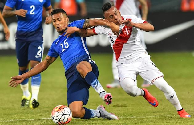 Peru's Christian Cueva (R) challenges Michael Orozco of the US during an international friendly football match at RFK Stadium in Washington, DC, on September 4, 2015