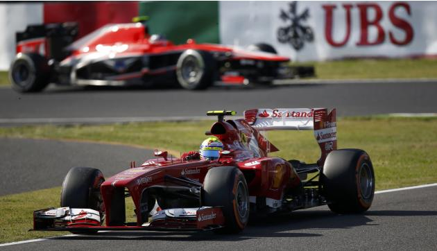 Ferrari Formula One driver Massa of Brazil drives during the qualifying session of the Japanese F1 Grand Prix at the Suzuka circuit