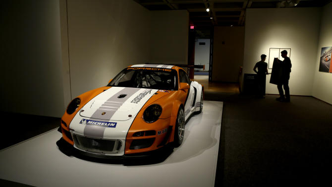 In this photo taken Wednesday, Oct. 9, 2013 a 2010 Porsche Type 911 GT3 R Hybrid Race Car Prototype is on display in the Porsche By Design exhibit at the North Carolina Museum of Art in Raleigh, N.C. (AP Photo/Gerry Broome)