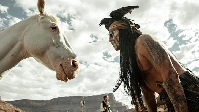 "FILE - This file publicity image released by Disney shows Johnny Depp, right, as Tonto, in a scene from ""The Lone Ranger."" For months, questions have swirled about whether developers, activists or tribes would be willing to plunk down millions to buy the Wounded Knee National Landmark. Now there's a new potential buyer in the mix: Johnny Depp. (AP Photo/Disney Enterprises, Inc. and Jerry Bruckheimer Inc., Peter Mountain, File)"