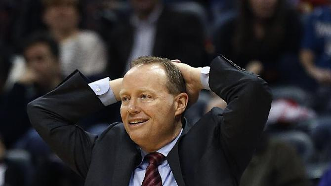 Atlanta Hawks coach Mike Budenholzer watches from in front of the bench in the second half of the Hawks' NBA basketball game against the Minnesota Timberwolves on Saturday, Feb. 1, 2014, in Atlanta. Atlanta won 120-113