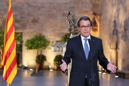 Handout photo of Catalonia's regional president Mas speaking after he signed a decree calling for the region's elections to be held on September 27 at Palau de la Generalitat in Barcelona