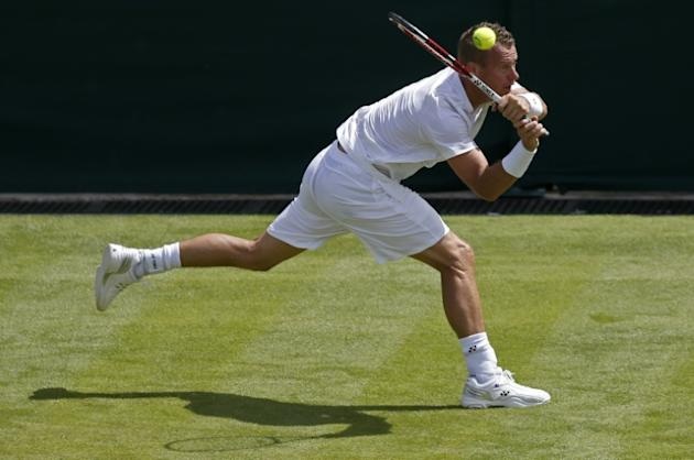 Lleyton Hewitt, pictured in action at Wimbledon in June, says it will be tough for Australia to win this year's Davis Cup with their semi-final opponents being Andy Murray's Great Britain