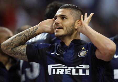 Inter Milan's Icardi celebrates after scoring against Juventus during their Italian Serie A soccer match in Milan