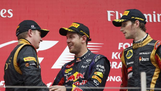 Red Bull Formula One driver Vettel speaks to Lotus Formula One driver Raikkonen after the Korean F1 Grand Prix in Yeongam