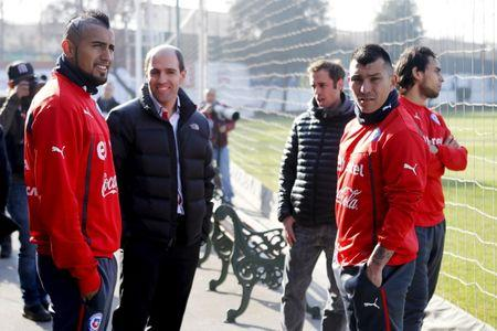 Chile's national soccer team players Vidal, Medel and Valdivia meet with Jadue, president of the National Association of Professional Soccer of Chile in Santiago