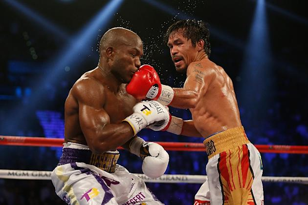 Manny Pacquiao (R) hung up his gloves after what was supposed to be a farewell victory over Timothy Bradley in April