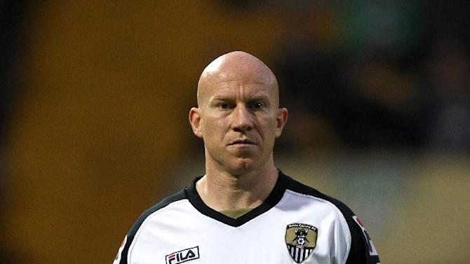 Oldham have played down reports linking them with Notts County striker Lee Hughes