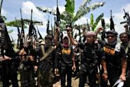 File photo shows rebels of breakaway Muslim separatist group, Bangsamoro Islamic Freedom Fighters during a clandestine press conference in Maguindanao province in August 2011. The group, armed with chainsaws and guns, launched attacks across 11 towns in the southern Philippines on Monday