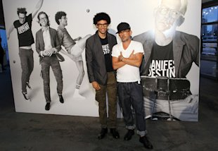 Designer Mark McNairy, right, poses with a Gap model wearing the Manifest Destiny T-shirt at the Gap x GQ party (McNairy is wearing the shirt in the poster behind them). (Photo: GQ.com)