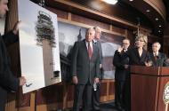 Sen. Barbara Boxer, D-Calif., second from right, points to a photo of a control tower being built in Palm Springs, Calif., that suffered some damage while under construction, Wednesday, Aug. 3, 2011, during a news conference on Capitol Hill in Washington. With her from left are: House Minority Whip Steny Hoyer of Md., Sen. Jay Rockefeller, D-W.Va., Sen. Charles Schumer, D-N.Y., Boxer, and Senate Majority Leader Harry Reid of Nev. (AP Photo/J. Scott Applewhite)