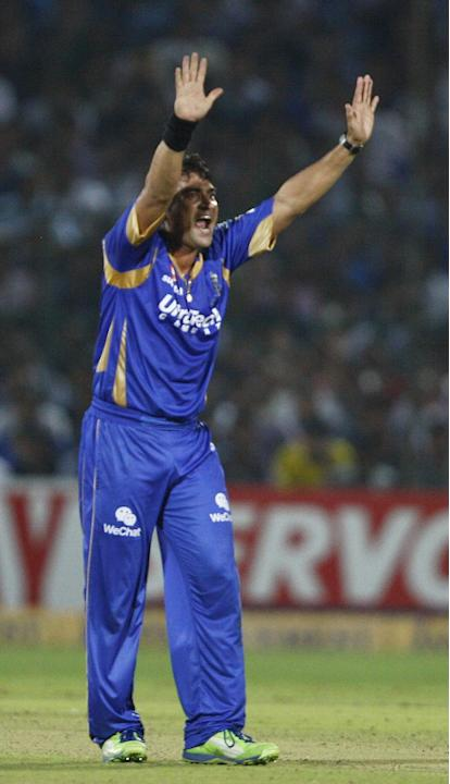 Rajasthan Royals bowler Pravin Tambe appeals for a wicket during the CLT20 1st Semi-Final between Rajasthan Royals and Chennai Super Kings at Sawai Mansingh Stadium in Jaipur on Oct. 4, 2013.