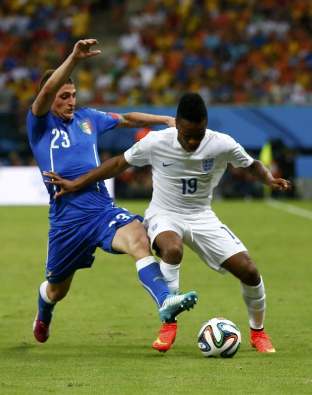 Italy's Marco Verratti fights for the ball with England's Raheem Sterling during their 2014 World Cup Group D soccer match at the Amazonia...