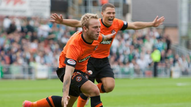 Johnny Russell, left, opened the scoring as Dundee United stormed past Hibernian