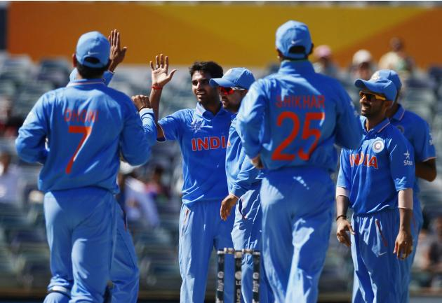 India's bowler Bhuvneshwar Kumar celebrates with team mates after UAE's Amjad Ali was caught behind by India's wicket keeper MS Dhoni during their Cricket World Cup match in Perth