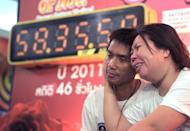 Thai couple Ekkachai (L) and Laksana Tiranarat show off their new world record for the longest smooch, on February 14, 2013. The pair locked lips for 58 hours, 35 minutes and 58 seconds, smashing last year's Guinness World Record by more than eight hours
