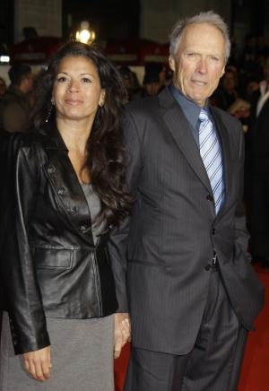 "FILE - In this Jan. 31, 2010 file photo, U.S. Director Clint Eastwood, right, arrives with his wife, Dina Eastwood, on the red carpet for the UK premiere of ""Invictus"" at London's Leicester Square. A new E! reality show, ""Mrs. Eastwood & Company,"" debuts Sunday, May 20, 2012. (AP Photo/Joel Ryan, File)"