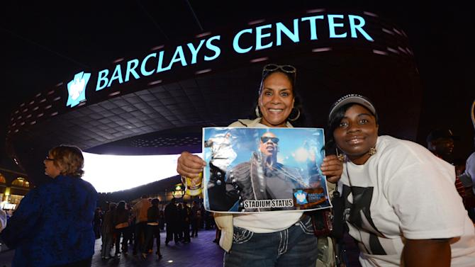 Gigi White, left, and Rashida White, both of Brooklyn, N.Y.,  arrive for the first of eight Jay-Z shows which will open the Barclays Center in the Brooklyn borough of New York, Friday, Sept. 28, 2012. (AP Photo/Henny Ray Abrams)