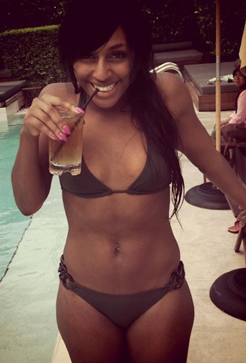 Celebrities in bikinis: It's no wonder Alexandra Burke is smiling – if we looked this good in a swimsuit and were by a pool we'd be this happy too!
