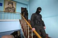 Pro-Russian supporters break into the territory of the naval headquarters in Sevastopol, March 19, 2014. REUTERS/Baz Ratner