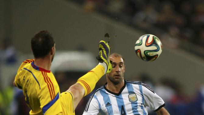 Romania's Rat Dinca challenges Argentina's Zabaleta during their international friendly soccer match at the National Arena in Bucharest