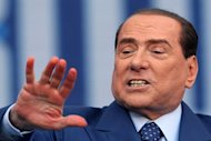 Former Italian prime minister Silvio Berlusconi gives a speech in Bari, on April, 13, 2013. The court of appeals in Milan has postponed to May 8 a hearing in Berlusconi's trial for tax fraud linked to his television business empire