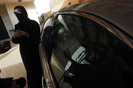 A female Saudi motorist speaks to the media after driving her vehicle in defiance of the ban on driving in Riyadh June 22, 2011. REUTERS/Fahad Shadeed/Files