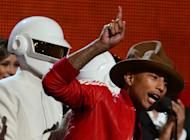 Pharrell Williams (R) at the 56th Grammy Awards