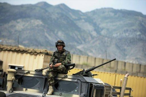 This file photo shows an Afghan soldier sitting on top of a military vehicle at a base in Khost Province, pictured on August 14, 2012. A suicide car bombing hit a US-run base in Khost on Wednesday, killing at least three Afghans and wounding seven others, according to officials.