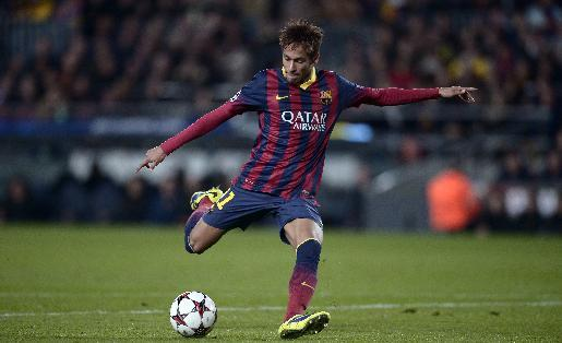 FC Barcelona's Neymar, from Brazil, kicks the ball against Celtic during a Champions League soccer match group H at the Camp Nou in Barcelona, Spain, Wednesday, Dec. 11, 2013