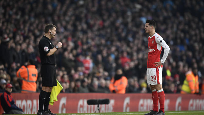 Arsenal's Granit Xhaka looks dejected after being sent off