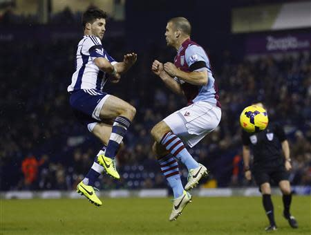 West Bromwich Albion's Long challenges Aston Villa's Vlaar for the ball during their English Premier League soccer match at The Hawthorns in West Bromwich