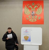 Six observers watched the presidential election vote in one Moscow polling station, often outnumbering the voters, while wires trailed from an unobtrusive webcam mounted on a column opposite the ballot boxes