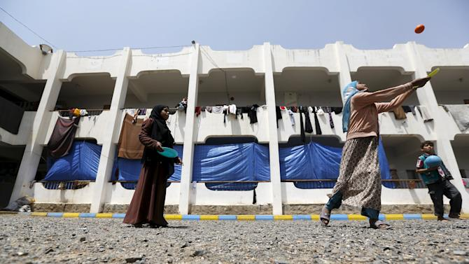Girls play at a school in Yemen's capital Sanaa sheltering them and their families